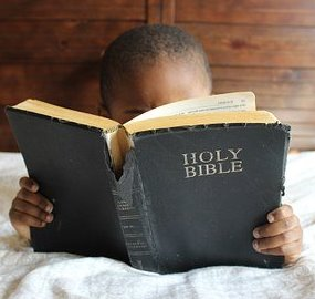 Child reading the bible